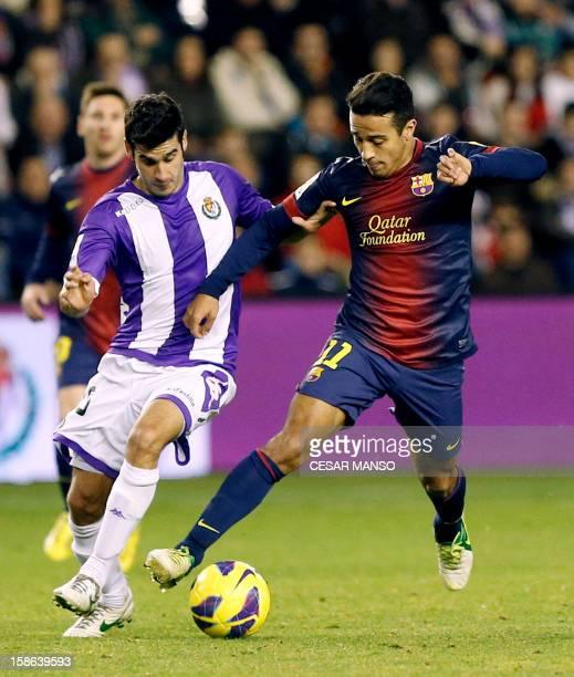 Barcelona's midfielder Thiago Alcantara vies with Valladolid's midfielder Oscar Gonzalez during the Spanish league football match Real Valladolid vs...