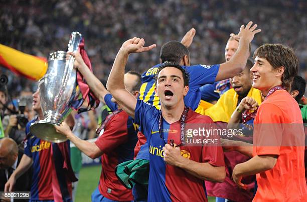 Barcelona´s midfielder Xavi celebrates with teammates after winning the Champions League Cup on May 27, 2009 at the Olympic Stadium in Rome....
