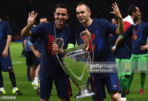 Barcelona's midfielder Xavi Hernandez and Barcelona's midfielder Andres Iniesta celebrate with the trophy after the UEFA Champions League Final...