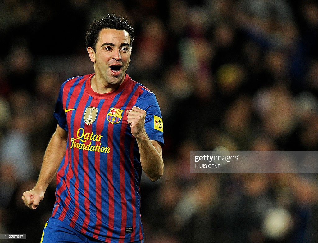 Barcelona's midfielder Xavi Hernandez celebrates after scoring a goal against Granada on March 20, 2012 during a Spanish league football match at the Camp Nou stadium in Barcelona.