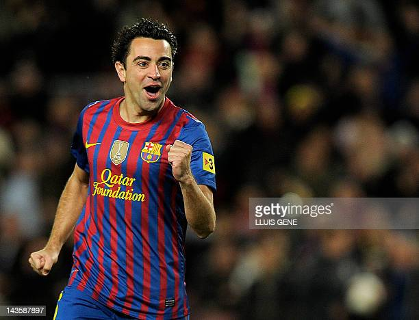 Barcelona's midfielder Xavi Hernandez celebrates after scoring a goal against Granada on March 20, 2012 during a Spanish league football match at the...