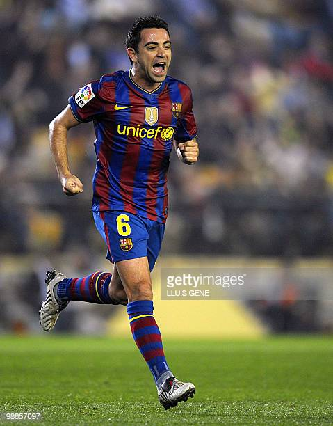 Barcelona's midfielder Xavi Hernandez celebrates after scoring against Villarreal during a Spanish League football match on May 01 2010 at Madrigal...
