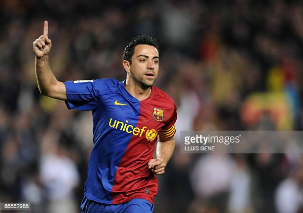Barcelona's midfielder Xavi Hernandez celebrates after scoring during a Spanish League football match against Malaga on March 22 2009 at the Camp Nou...