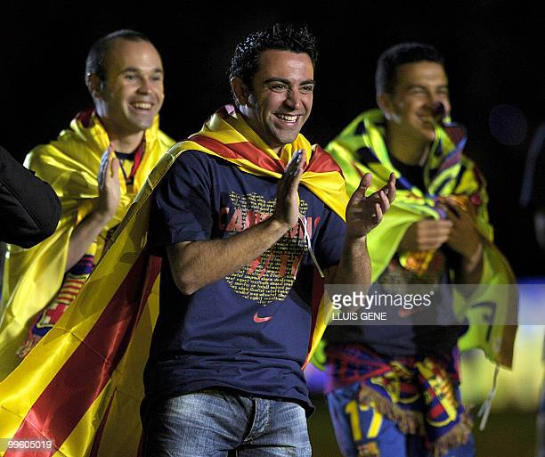 Barcelona's midfielder Xavi Hernandez celebrates after winning the Spanish La Liga title at Camp Nou stadium in Barcelona on May 16 2010 Barcelona...