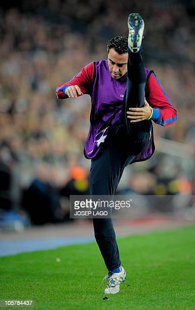 Barcelona's midfielder Xavi Hernandez gestures during their UEFA Champions League football match against Copenhagen at the Camp Nou stadium in...