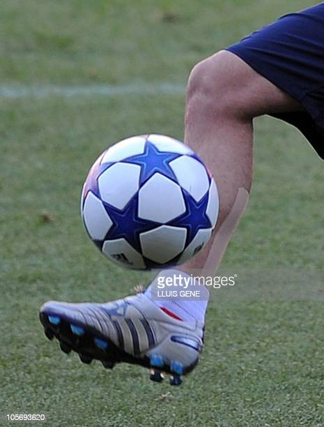 Barcelona's midfielder Xavi Hernandez uses the strips protection during a training session at the Camp Nou stadium in Barcelona on October 19 2010 in...