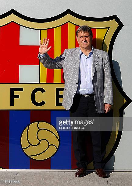 Barcelona's new Argentinian coach Gerardo 'Tata' Martino poses during his official presentation at the Camp Nou stadium in Barcelona on July 25 2013...