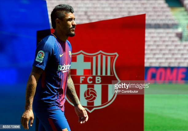 Barcelona's new Brazilian football player Paulinho Bezerra enters the pitch during his official presentation after signing his new contract with the...