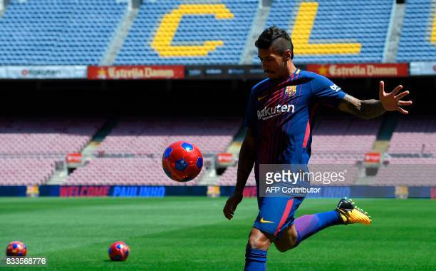 Barcelona's new Brazilian football player Paulinho Bezerra kicks a ball during his official presentation after signing his new contract with the...