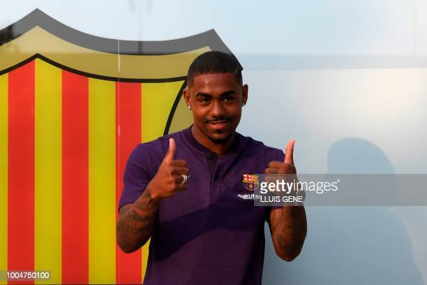 Barcelona's new Brazilian forward Malcom gives thumbs up at the Camp Nou stadium in Barcelona on July 24 2018 Spanish champions Barcelona announced...