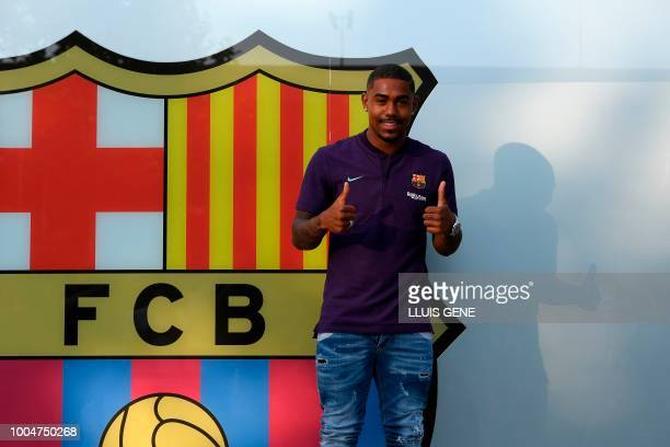 TOPSHOT Barcelona's new Brazilian forward Malcom gives thumbs up at the Camp Nou stadium in Barcelona on July 24 2018 Spanish champions Barcelona...