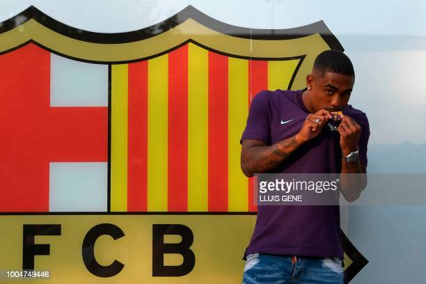 Barcelona's new Brazilian forward Malcom poses at the Camp Nou stadium in Barcelona on July 24, 2018. - Spanish champions Barcelona announced they...
