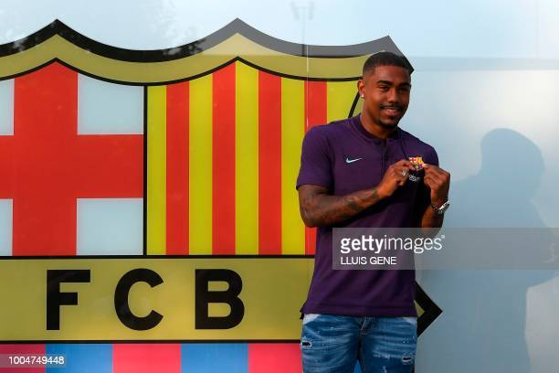 Barcelona's new Brazilian forward Malcom poses at the Camp Nou stadium in Barcelona on July 24 2018 Spanish champions Barcelona announced they have...