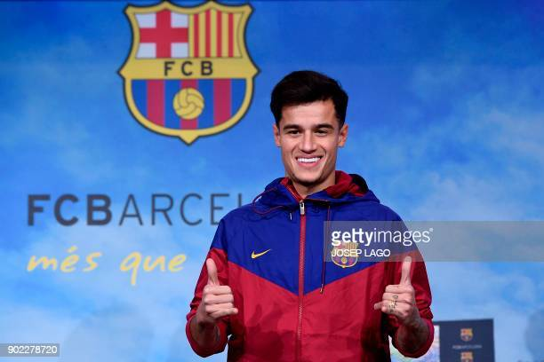 Barcelona's new Brazilian midfielder Philippe Coutinho poses for a picture in Barcelona on January 7 2018 Coutinho is in Barcelona to tie up a...