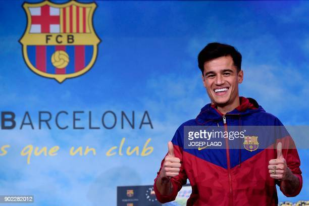 TOPSHOT Barcelona's new Brazilian midfielder Philippe Coutinho poses for a picture in Barcelona on January 7 2018 Coutinho is in Barcelona to tie up...