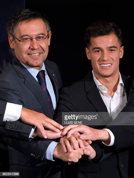Barcelona's new Brazilian midfielder Philippe Coutinho poses with Barcelona FC President Josep Maria Bartomeu during his official presentation in...