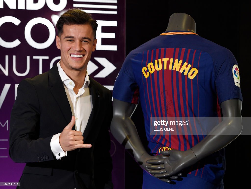 Barcelona's new Brazilian midfielder Philippe Coutinho poses with his new jersey during his official presentation in Barcelona on January 8, 2018. Philippe Coutinho officially joined Barcelona today, completing a move from Liverpool thought to be worth 160 million euros ($192 million), making it the third richest transfer in history. GENE