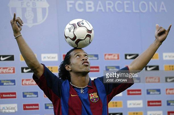 Barcelona's new Brazilian soccer star Ronaldinho balances the ball on his head during his official presentation at the Nou Camp Stadium in Barcelona...