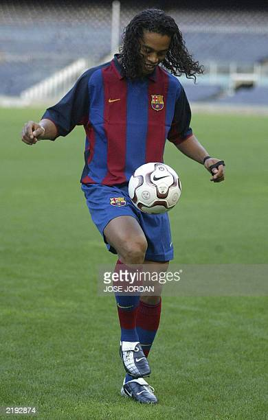 Barcelona's new Brazilian soccer star Ronaldinho plays with the ball in his official presentation at the Nou Camp Stadium in Barcelona 21 July 2003...