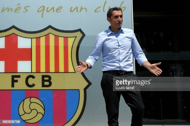 Barcelona's new coach Ernesto Valverde gestures as he poses outside the Camp Nou stadium in Barcelona on May 31 2017 prior to signing his new...