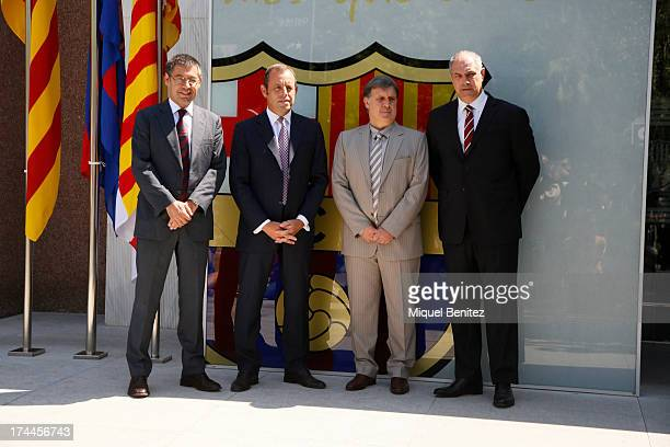Barcelona's new coach Gerardo 'Tata' Martino shakes hands with Barcelona's President Sandro Rosell during his presentation at the Camp Nou stadium on...