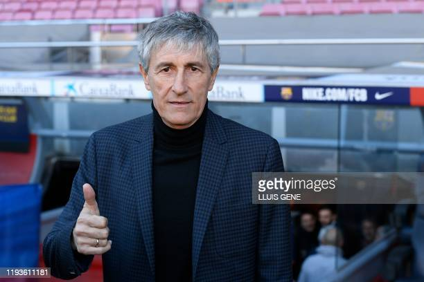 Barcelona's new coach Quique Setien poses during his official presentation at the Camp Nou stadium in Barcelona on January 14 2020