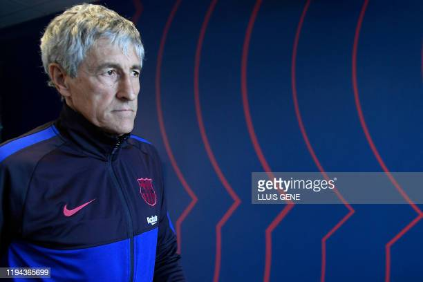 Barcelona's new coach Spaniard Quique Setien leaves after holding a press conference at the Joan Gamper Sports City training ground in Sant Joan...