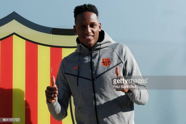 Barcelona's new Colombia midfielder Yerry Mina poses for a picture in Barcelona on January 12 2018 Colombia Yerry Mina joined Barcelona from...