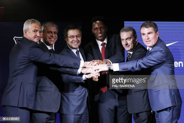 Barcelona's new Colombian defender Yerry Mina poses with Barcelona president Josep Maria Bartomeu along with members of the football club's board of...