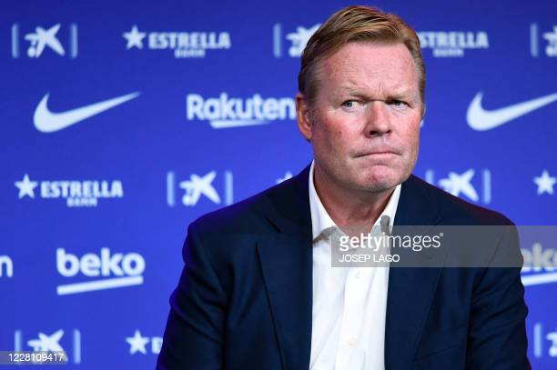 Barcelona's new Dutch coach Ronald Koeman holds a press conference during his official presentation at the Camp Nou stadium in Barcelona on August...