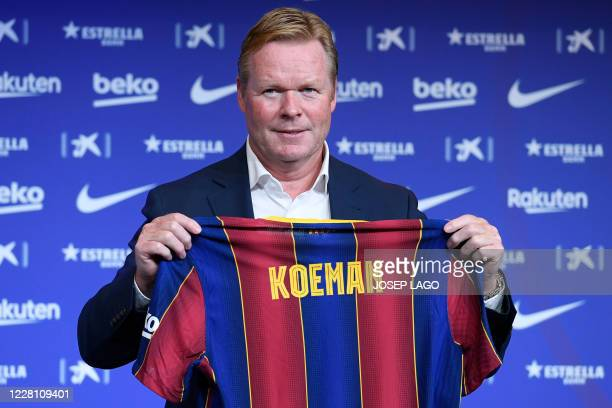 Barcelona's new Dutch coach Ronald Koeman poses during his official presentation at the Camp Nou stadium in Barcelona on August 19, 2020. -...
