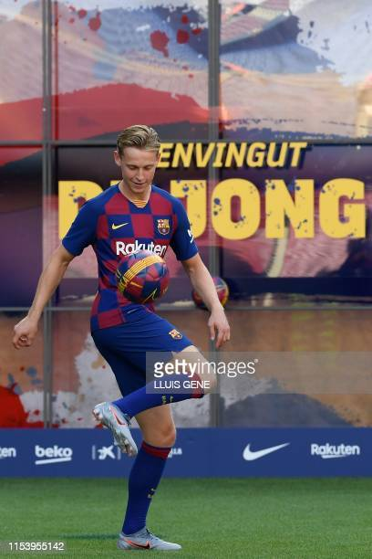 Barcelona's new Dutch midfielder Frenkie de Jong controls a ball during his official presentation at the Camp Nou stadium in Barcelona on July 5 2019