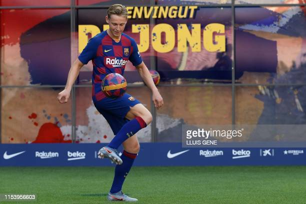 Barcelona's new Dutch midfielder Frenkie de Jong controls a ball during his official presentation at the Camp Nou stadium in Barcelona on July 5,...