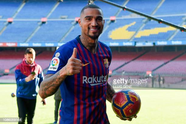 Barcelona's new Ghanaian forward KevinPrince Boateng gives a thumbsup as he arrives for his official presentation at the Camp Nou stadium in...