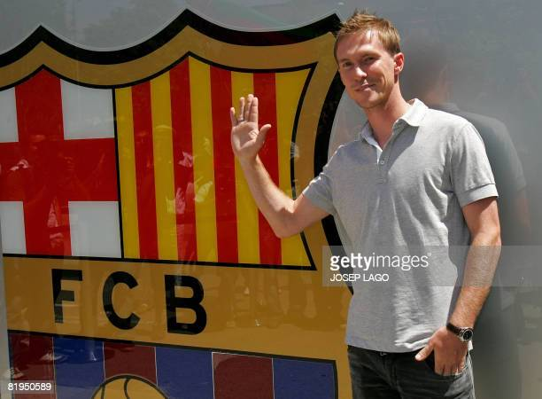 Barcelona's new player Alexander Hleb poses outside the Nou Camp stadium in Barcelona after agreeing terms with the Catalan club in Barcelona on June...