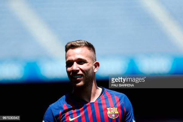 Barcelona's new player Brazilian midfielder Arthur Henrique Ramos de Oliveira Melo poses during his official presentation at the Camp Nou Stadium in...