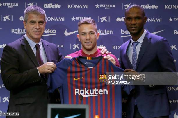 Barcelona's new player Brazilian midfielder Arthur Henrique Ramos de Oliveira Melo poses with Barcelona's vicepresident Spanish Jordi Mestre and...