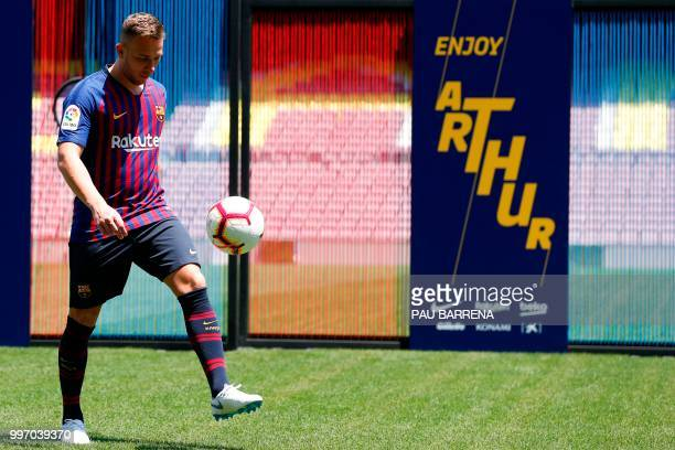 Barcelona's new player Brazilian midfielder Arthur Henrique Ramos de Oliveira Melo kicks the ball during his official presentation at the Camp Nou...