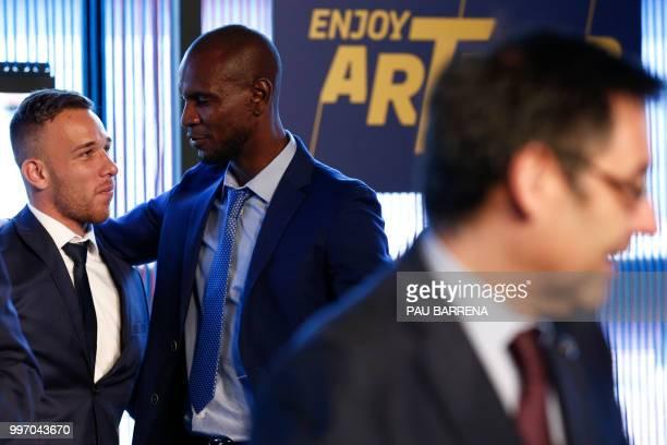 Barcelona's new player Brazilian midfielder Arthur Henrique Ramos de Oliveira Melo poses next to Barcelona's technical secretary French Eric Abidal...