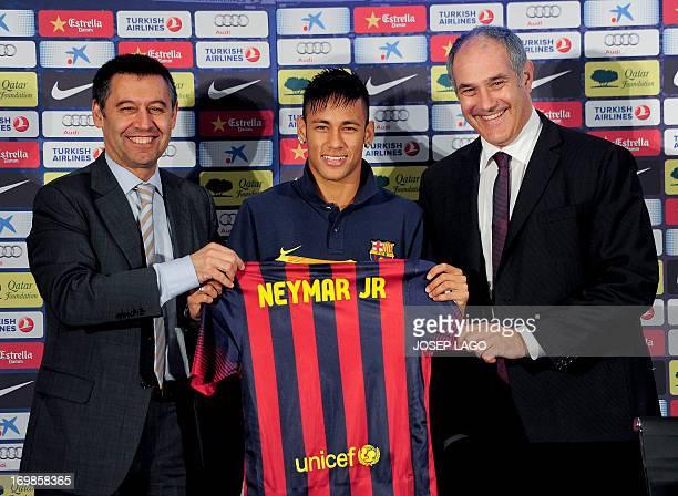 FC Barcelona's new player Brazilian Neymar da Silva Santos Junior flanked by Barcelona's president Sandro Rosell and Barcelona's sports director...