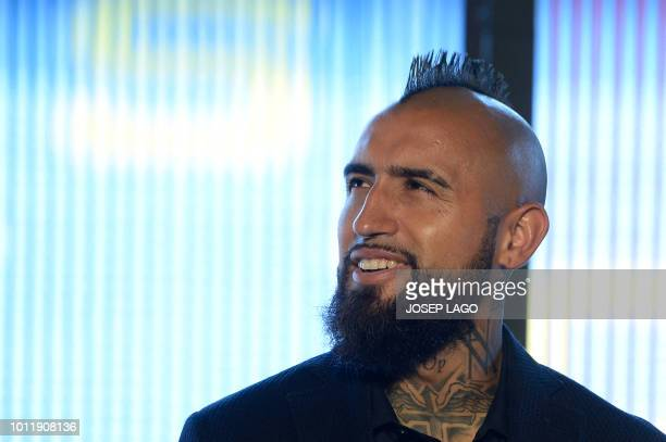 Barcelona's new player Chilean midfielder Arturo Vidal poses during his official presentation at the Camp Nou stadium in Barcelona on August 6, 2018.