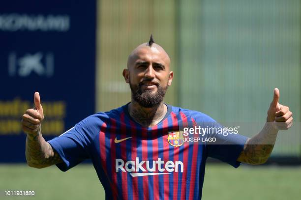 Barcelona's new player Chilean midfielder Arturo Vidal poses during his official presentation at the Camp Nou stadium in Barcelona on August 6 2018