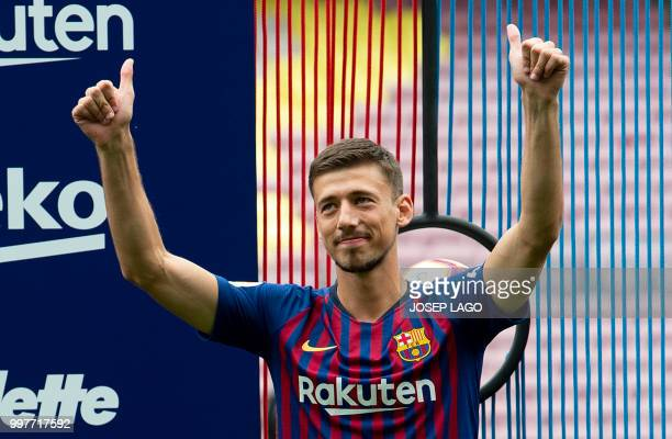 Barcelona's new player French defender Clement Lenglet poses during his official presentation at the Camp Nou stadium in Barcelona on July 13 2018...