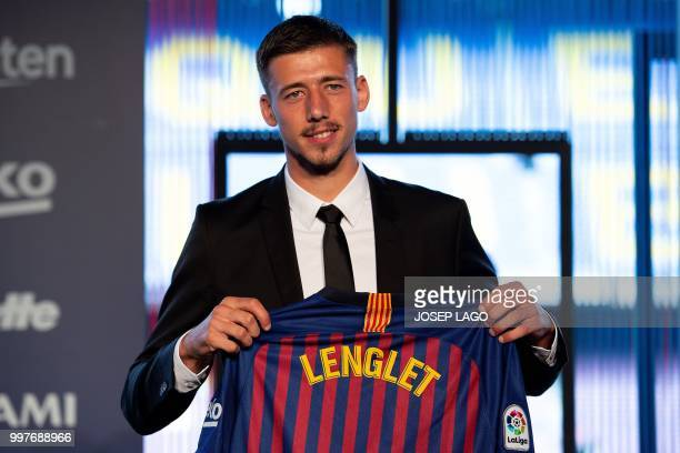 Barcelona«'s new player French defender Clement Lenglet poses with his new jersey during his official presentation at the Camp Nou stadium in...