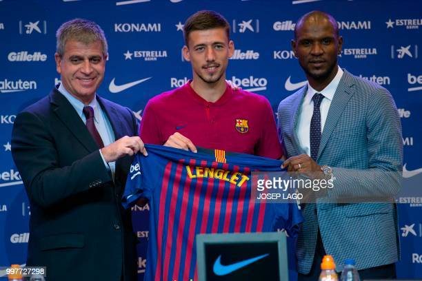 Barcelona's new player French defender Clement Lenglet poses with with Barcelona's technical secretary French Eric Abidal and Barcelona's...