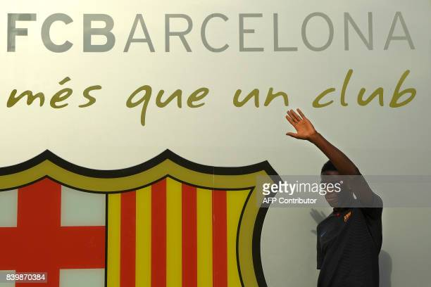 Barcelona's new player French Ousmane Dembele poses outside the Camp Nou stadium in Barcelona prior to signing his new contract with the Catalan club...