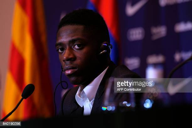 Barcelona's new player Ousmane Dembele looks on as he gives a press conference at the Camp Nou stadium in Barcelona during his official presentation...