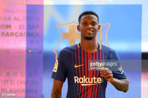 Barcelona's new player Portuguesse Nelson Semedo poses with his new jersey during his official presentation after signing his new contract with the...