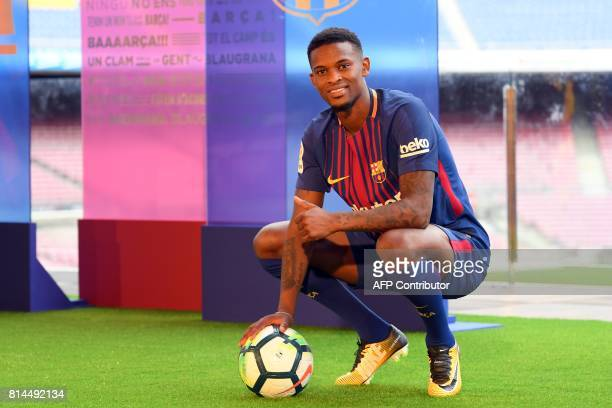 Barcelona's new player Portuguesse Nelson Semedo poses with his new jersey and a ball during his official presentation after signing his new contract...