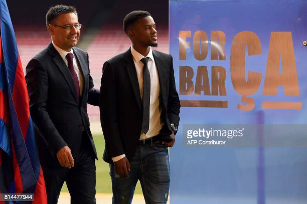 Barcelona's new Portuguese player Nelson Semedoarrives with Barcelona's president Josep Maria Bartomeu before his official presentation after signing...